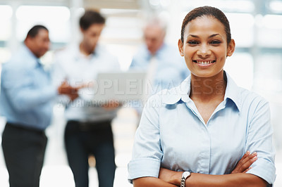 Buy stock photo Confident business woman smiling with colleagues in the background