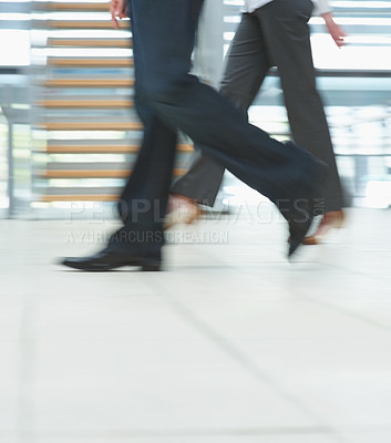 Buy stock photo Low section motion image of business people walking at the office