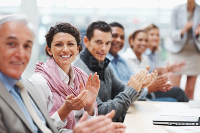 Buy stock photo Successful business men and woman applauding at a conference