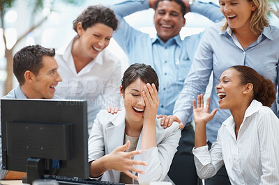 Buy stock photo Business colleagues laughing at funny email