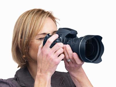 Buy stock photo Portrait of middle aged female taking photo using digital camera isolated over white background