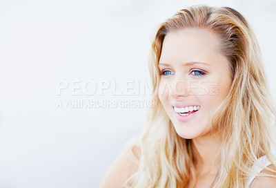 Buy stock photo Closeup of a young happy woman looking at copyspace
