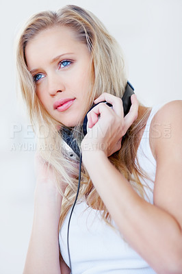 Buy stock photo Beautiful young female with headphones around her neck