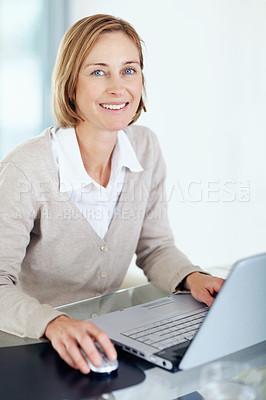 Buy stock photo Portrait of happy businesswoman using laptop at her desk - Indoors