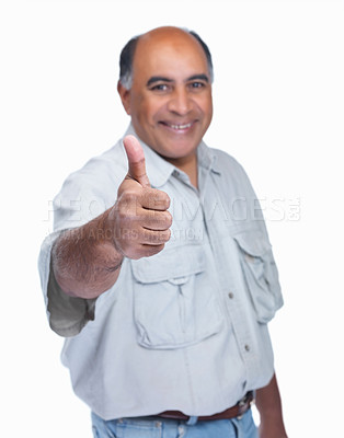 Buy stock photo A happy mature man showing a thumbs up sign on white background