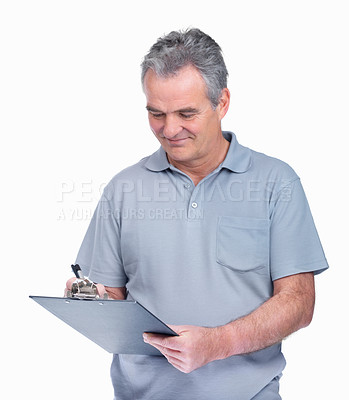 Buy stock photo Portrait of a smiling elderly man with a notepad on while making notes
