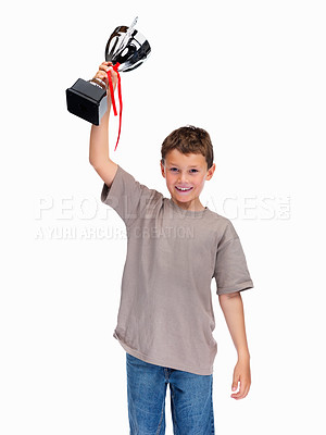 Buy stock photo Smiling little champion with his trophy isolated against white background