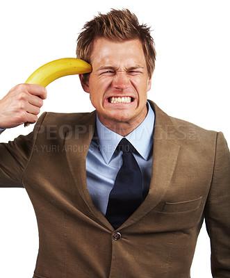 Buy stock photo Banana Gun. Overworked businessman having a breakdown.