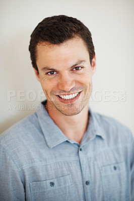 Buy stock photo Portrait of happy young man smiling