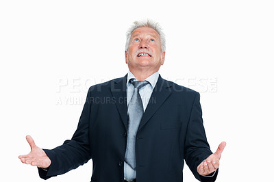 Buy stock photo Portrait of frustrated senior business man looking up in despair over white background