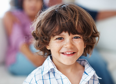 Buy stock photo Closeup portrait of happy little boy smiling with grandparents in background