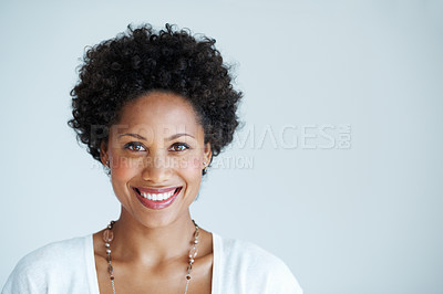 Buy stock photo Closeup of beautiful African American woman smiling on plain background