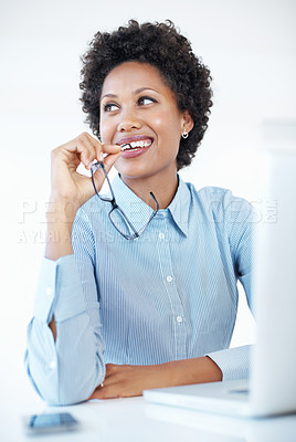 Buy stock photo Thoughtful African American business woman smiling at work