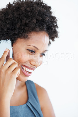 Buy stock photo Closeup of beautiful African American woman smiling while using cellphone
