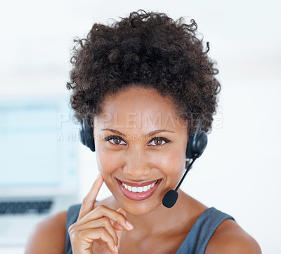 Buy stock photo Closeup portrait of young female call centre employee with headset smiling at work