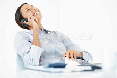 Buy stock photo Laughing mixed race business woman using mobile phone at work
