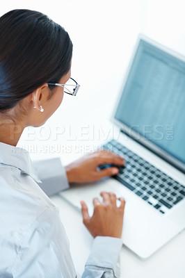 Buy stock photo Mixed race female professional using laptop over background