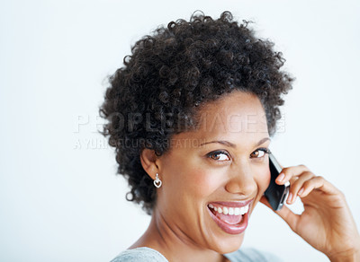Buy stock photo Closeup portrait of charming young woman talking on mobile phone over white background