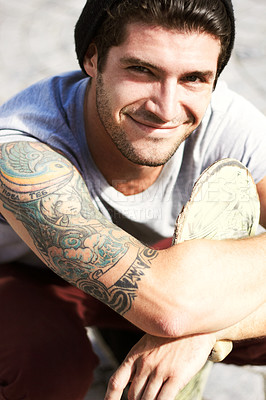 Buy stock photo Portrait of a young man showing off his beautiful Art Nouveau style tattoo