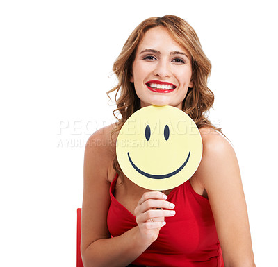 Buy stock photo A charismatic young woman holding a paddle with a smiley face on it