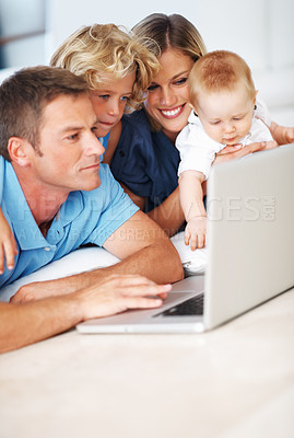 Buy stock photo Middle aged man using laptop with beautiful wife and kids