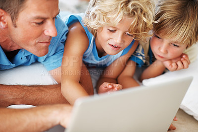 Buy stock photo Closeup of handsome man with cute sons using laptop at home