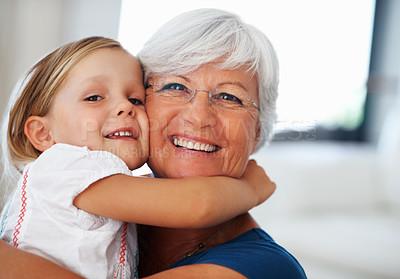 Buy stock photo Closeup of adorable little girl hugging senior woman