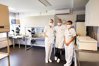Buy stock photo Team of science technicians standing together in modern laboratory