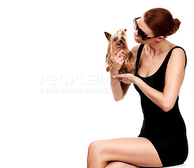 Buy stock photo A stylish redhead sitting and blowing kisses at her yorkshire terrier