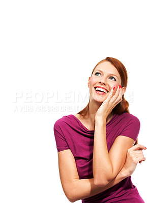 Buy stock photo A pretty redhead gazing into the distance with her hand on her cheek - Isolated