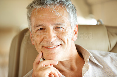 Buy stock photo Portrait of a handsome senior man sitting in an airplane - closeup