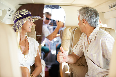 Buy stock photo Mature couple talking to the pilot while on a private jet and headed on a trip