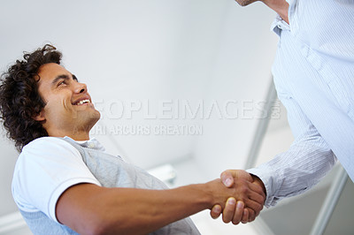 Buy stock photo Young business entrepreneurs shaking hands