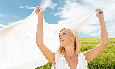 Buy stock photo A beautiful young woman holding a scarf in the breeze