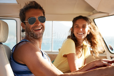 Buy stock photo Handsome male wearing glasses smiling and laughing with his girlfriend in the background