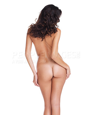 Buy stock photo Rearview studio shot of an unrecognizable nude woman standing against a white background
