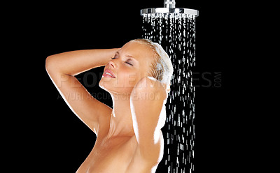 Buy stock photo Stunning young woman taking a soapy shower while isolated on black