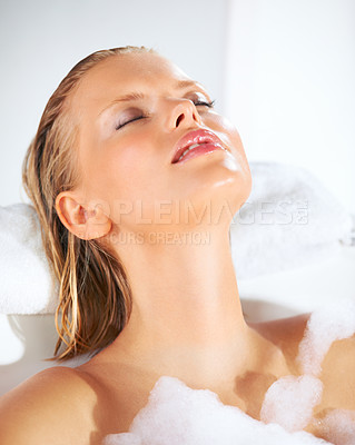 Buy stock photo Relaxed young beauty in her foamy bubble bath