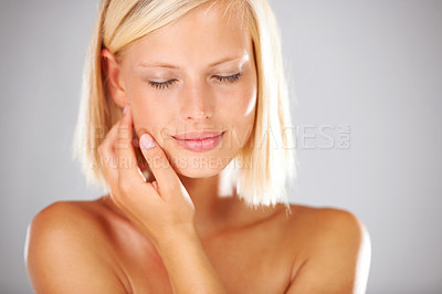 Buy stock photo Closeup of a stunning young woman touching her face