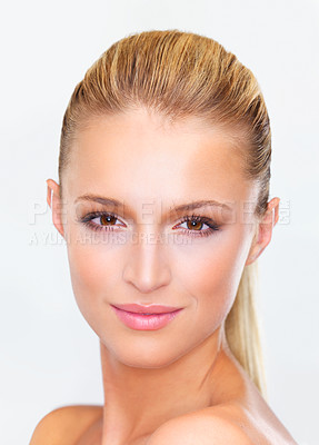 Buy stock photo Closeup of a naturally beautiful woman with flawless skin gazing at you, isolated on white