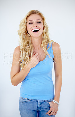 Buy stock photo Portrait of a pretty young woman laughing at you while isolated on white