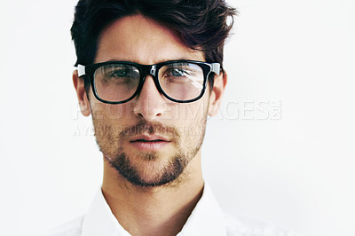 Buy stock photo Cropped portrait of a handsome male sporting black rimmed glasses next to copyspace