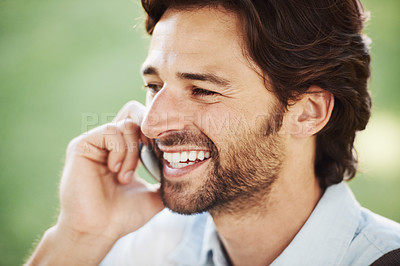 Buy stock photo Shot of a handsome young man in the park
