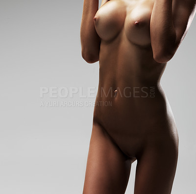 Buy stock photo Cropped view of a woman's exposed nude body isolated on grey