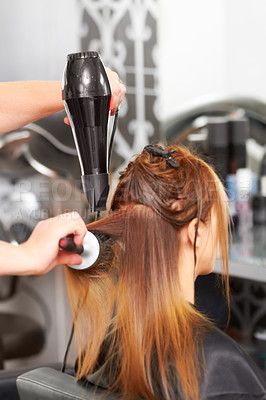 Buy stock photo Rear view of a woman getting her hair dried at the hairdresser
