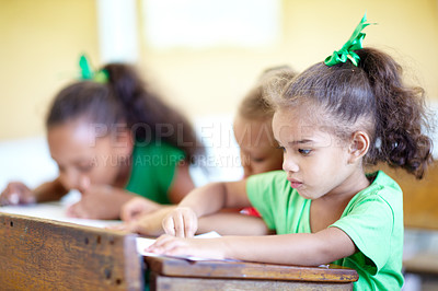 Buy stock photo Cute little preschoolers sitting in a classroom and drawing together