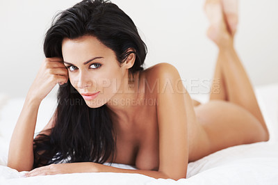 Buy stock photo Portrait of a sensual nude woman lying down on a bed