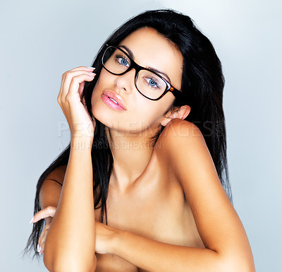 Buy stock photo A closeup portrait of a beautiful topless model wearing glasses with her head resting on her chin