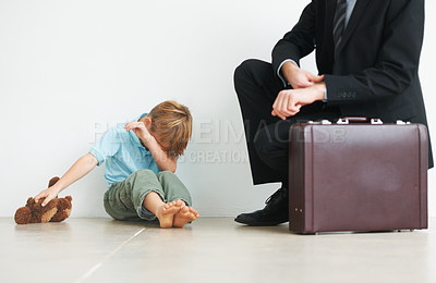 Buy stock photo A young boy crying because his dad has to go to work