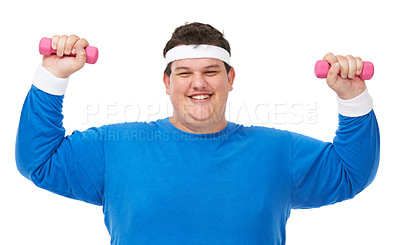 Buy stock photo A studio shot of a young obese man lifting weights triumphantly over his head